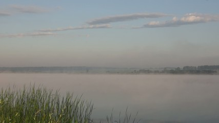 ummer morning panorama of the foggy lake