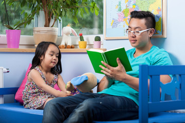 Asian dad reading fairytale