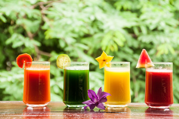 Colorful glasses of fruit and vegetable juice