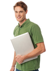Smiling young man holding laptop