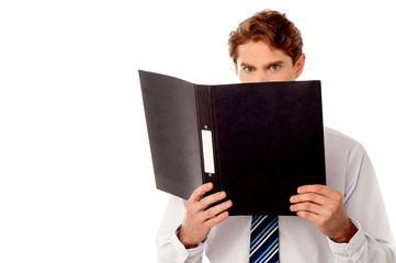 Male secretary in anger reviewing file