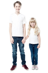 Happy brother and sister, studio shot