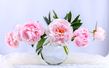 Still life with beautiful pink peonies in green vase