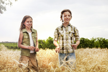 young boys having fun in the wheat field