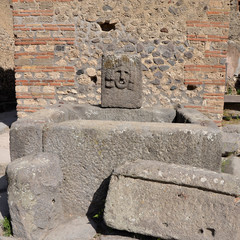 Ancient fountain in the streets of Pompeii