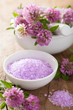 spa with purple herbal salt and clover flowers