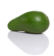Fresh green avocado. Isolated on white background.