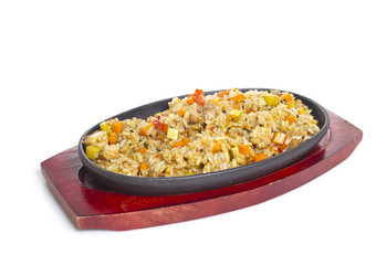 Thai rice with meat and vegetables isolated.