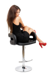 young gorgeous caucasian brunette in black dress on the chair, s