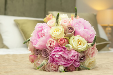 Wedding bouquet for bride on the bed