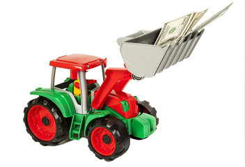 Red and green toy bulldozer with dollars