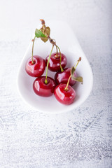 Cherries in a white dish