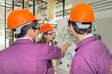 Engineer student looking simulated diagram in laboratory