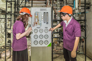 Engineer student looking gauge of Simulated oil distillation in