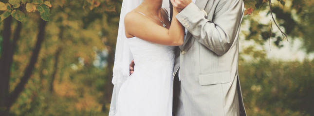 Loving newlywed couple outdoor.