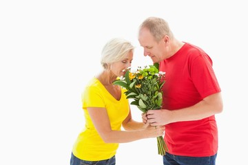 Mature man offering his partner flowers