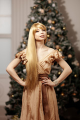 Luxury blonde in interior New Year. Young beauty trendy girl cel
