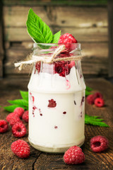 Raspberry dessert in a glass jar
