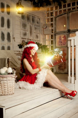 Young beautiful smiling santa woman. Christmas Fashionable luxur