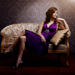 Fashion luxury model in purple dress. Young beauty style girl. B