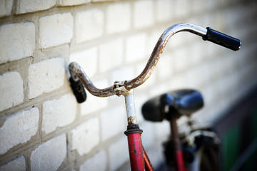 the old bicycle costs at a house wall