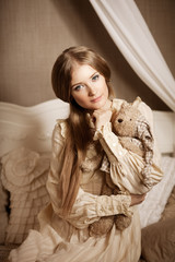 Beautiful young girl in vintage dress. Gentle pretty woman the c
