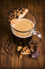 coffee in a glass cup with chocolate biscuits