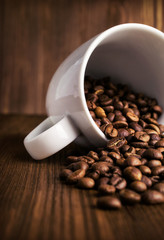 coffee beans in white cup close-up