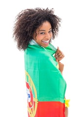 Girl wrapped up in portugal flag smiling at camera