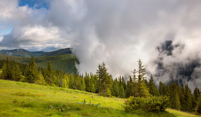 Majestic fog and clouds in the  Mountain valley landscape