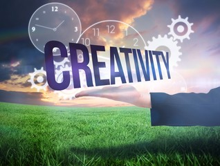 Businesswomans hand presenting the word creativity