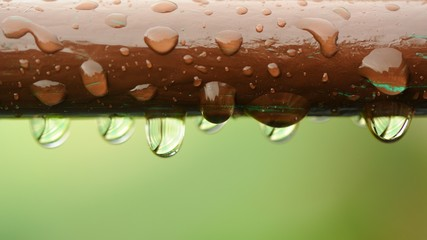 Water Drops on Brown Rail Close-Up (16:9 Aspect Ratio)