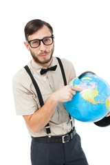 Geeky hipster pointing to globe