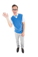 Geeky young hipster waving at camera