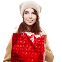 girl holding red shopping bag