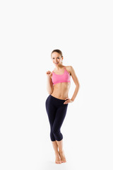 Young beautiful woman posing in a gym outfit.
