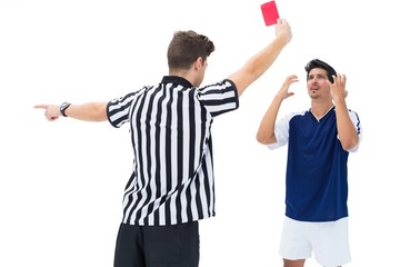 Referee sending off football player