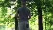 Man missed basketball throw on court in park, super slow motion