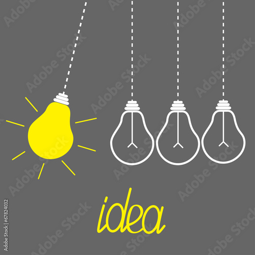Hanging yellow light bulbs. Perpetual motion. Idea concept. Grey - 67824032