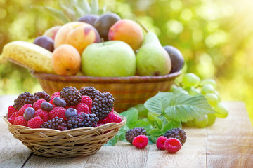 Fresh organic fruits in wicker basket