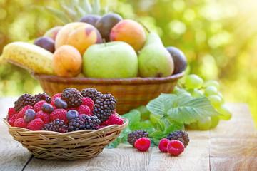 Fresh organic fruits in wicker basket