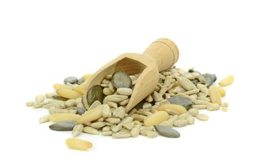 Mixed pine nuts, sunflower and pumpkin seeds with wooden scoop