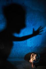 Man shadow hitting naked woman. Rape or domestic violence victim