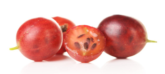 Ripe gooseberries isolated on white.