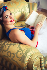 Pin Up Girl with Book on Chair