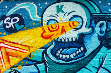 Graffiti of skull with laser eyes