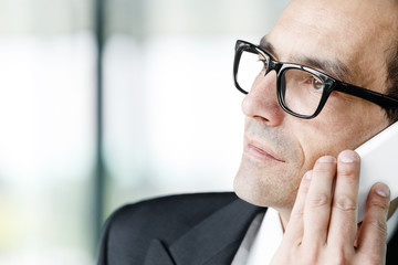 Daydreaming Adult businessman talking on phone