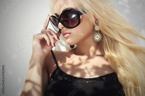 beautiful woman in sunglasses.beauty blond girl.Summer