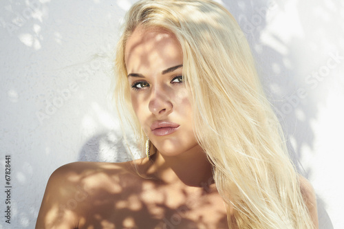 beautiful blond woman.top model.shadow on the face
