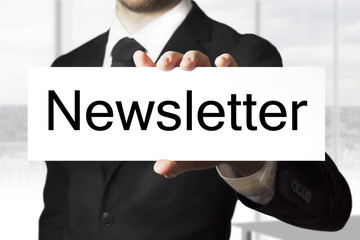 businessman holding sign newsletter